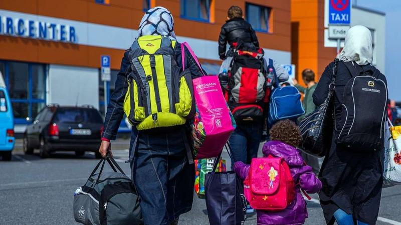 Политика: Большинство немцев хотят верхнего предела для беженцев